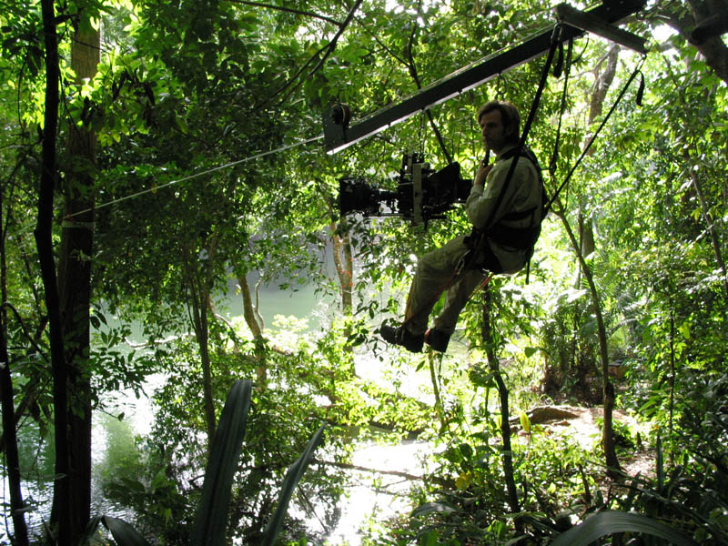 Glenn Warner suspended in the canopy of the jungle for some overhead tracking shots. Grip riggers created the rig specifically for the shoot.